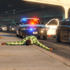 Officer clearing a vehicle after a shooting with a suspect